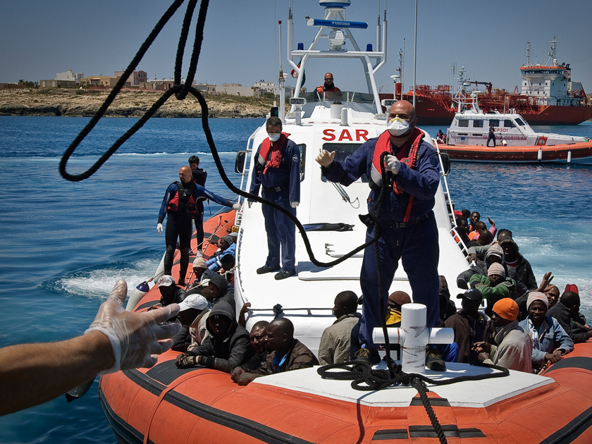 An Italian coastguard vessel prepares to dock in Lampedusa's port.
